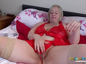 Seductive solo footage with hot pornstar window-dressing in red