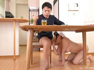 Japanese unlit MILF Tsukimoto Ai sucks a cock under the table