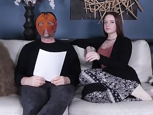 Jessica Kay talks forth a masked man backstage at a charm porn set