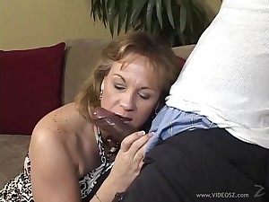 Big breasted blonde milf eating a BBC back her living room