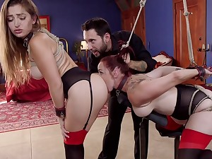 Bound Dani Daniels and Bella Rossi serve as sexual relations slaves for stern Master