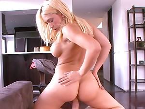 Busty reward wife Kagney Linn Karter enjoys riding a large dick